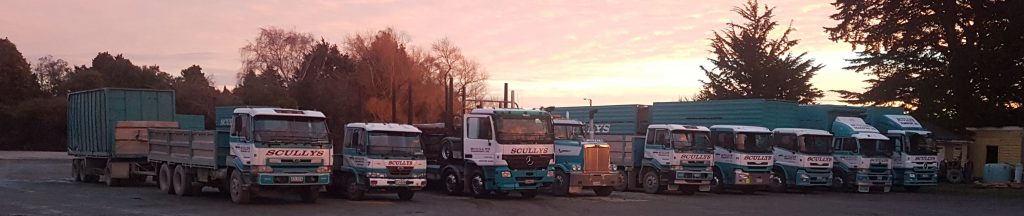 Scullys Transport trucks at sunset.